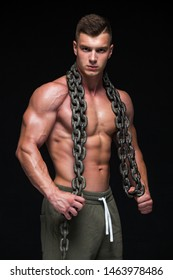 The Perfect male body - Awesome bodybuilder posing. Hold a chain. Isolated on white background. Copy Space.