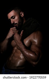 The Perfect Male Body - Stunning bodybuilder posing. Muscled young guy. Isolated on black background. Space for text