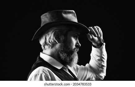 perfect male. detective acknowledgement or greeting. trilby hat. man in vintage style wide brimmed hat. Man with retro Hat. brutal bearded hipster in suit vest. mafia gentlemen club. mature cowboy