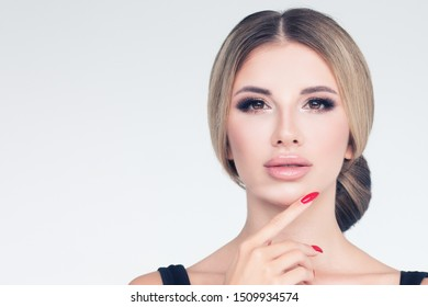 Perfect model woman face closeup. Pretty girl with updo haircut on white background