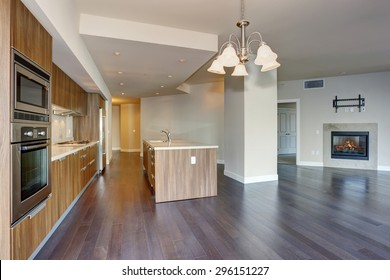 Perfect modern kitchen with hardwood floor and stainless steel fridge.