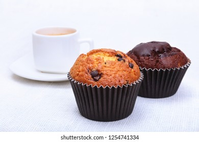 Perfect morning breakfast with Classic espresso in white cup, cake and chocolate on white background.