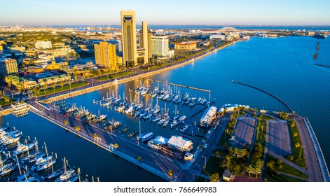 The perfect morning over Corpus Christi Texas bayfront harbor and marina aerial drone view high above Gulf of Mexico coastal bend city skyline cityscape with Harbor Bridge and reflections off water