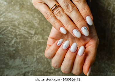 perfect nails design with botanical pattern. Females hands with manicure. Plant concept in nails art.