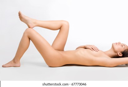 Perfect naked lady lying on the floor