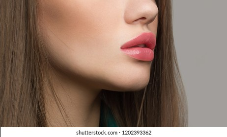 Perfect natural lip makeup. Close up macro photo with beautiful female mouth. Plump full lips. Close-up face detail. Perfect clean skin, light fresh lip make-up. Beautiful spa tender lip