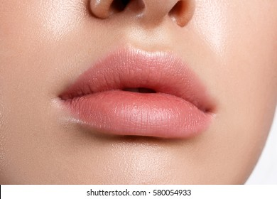 Perfect natural lip makeup. Close up macro photo with beautiful female mouth. Plump full lips.