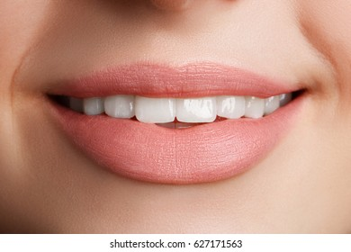 Perfect natural lip makeup. Close up macro photo with beautiful female mouth. Plump full lips.