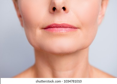 Perfect natural lip maqullage. Close up macro cropped photo with beautiful attractive female mouth, wellness, wellbeing, treatment, therapy concept, isolated on grey background