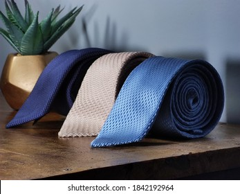 Perfect necktie close up. Shopping concept. Personal stylist service. Stylist advice. Matching necktie with outfit. Pick necktie. Different blue color necktie. Menswear clothes and accessories.