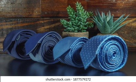 Perfect necktie close up. Shopping concept. Personal stylist service. Stylist advice. Matching necktie with outfit. Pick necktie. Different color necktie. Menswear clothes and accessories.