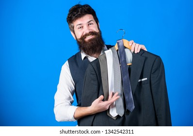 Perfect necktie. Shopping concept. Shop assistant or personal stylist service. Stylist advice. Matching necktie with outfit. Man bearded hipster hold neckties and formal suit. Guy choosing necktie.