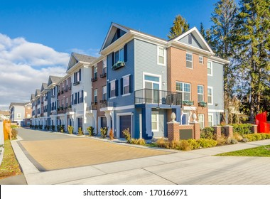A perfect neighborhood. Apartment buildings (townhouses) in suburb at Spring in the north America