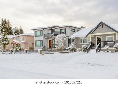 A perfect neighborhood. Houses in suburb at Winter in the north America.