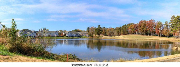 A perfect neighborhood with lake. Houses in suburb at autumn season in America