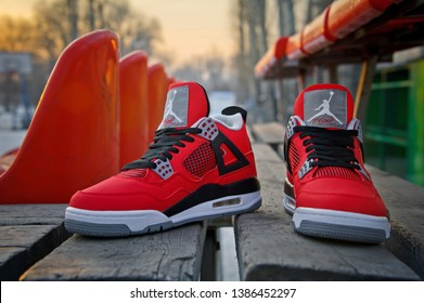 fb3e8332d85 Perfect Nike Air Jordan IV Retro sneakers in fire red, cement grey and  black colors