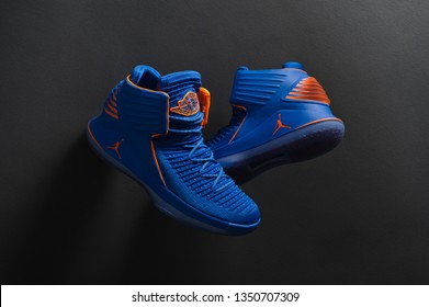 Perfect Nike Air Jordan XXXII 32 RUSS luxury basketball shoes in blue and orange colors shot on black background. Detailed view of sneakers by famous brand. Krasnoyarsk, Russia - December 19, 2017