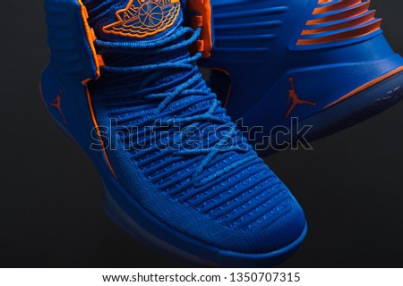 529890d1828529 Perfect Nike Air Jordan XXXII 32 RUSS luxury basketball shoes in blue and  orange colors shot on black background. Detailed view of sneakers by famous  brand.