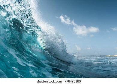 Perfect ocean wave breaking on the shore. Surfspot named Jailbreak, Maldives