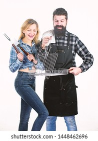 Perfect for ourdoor picnic. Bearded man and cute girl holding cooking grate with handle. Happy couple having grill grate for grilling. Hipster and woman with grate tools. BBQ grate for barbecue party.