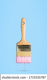 Perfect paintbrush with pink paint on blue. This file is cleaned and retouched.