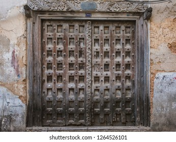 perfect picture of historic typical wooden door in Stone town zanzibar - Tanzania