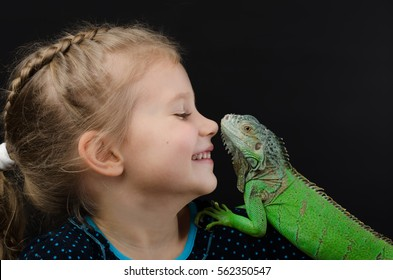 Perfect portrait little girl and green iguana