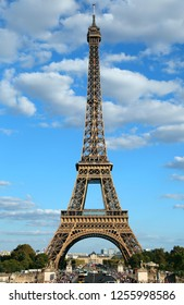 perfect poster of the Eiffel Tower in Paris in France vertically with the road below and the vivid colors very bright