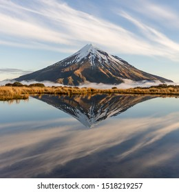 perfect reflection of Mount Taranaki Volcano next to New Plymouth in New Zealand
