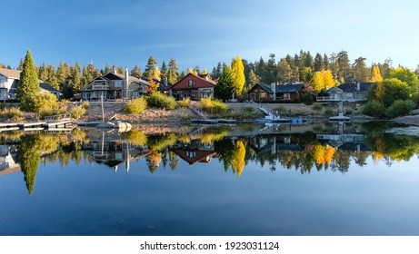 A perfect reflection of mountain cabins lining the Big Bear Lake