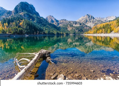 Perfect reflection within estany de Sant Maurici, Aiguestortes and Sant Maurici  National Park, Lleida, Catalonia, Spain