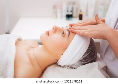 Perfect relaxation. Nice beautiful woman feeling relaxed while having massage in the beauty salon
