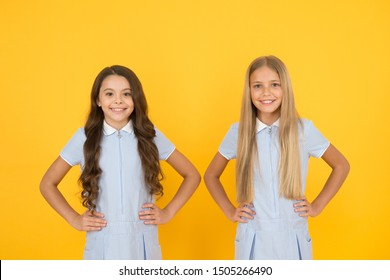 Perfect schoolgirls. Schoolgirls vintage simple style outfit. Cheerful schoolgirls yellow background. Little girls. Happy childrens day. Equal protection civil rights and freedom from discrimination.