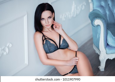 Perfect, sexy body, belly and breast of young woman wearing seductive lingerie. Beautiful hot female in underware posing in sensual way