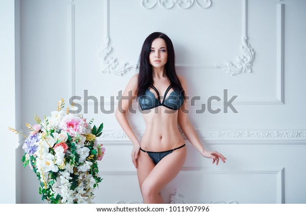 Very undressed fat woman on bed