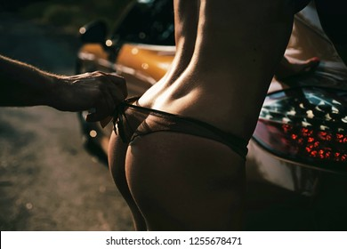 Perfect sexy butt near luxury sport car. Ideal woman's butt and hips. Perfect womans ass. Sexy butt with sensual touch
