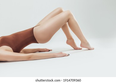Perfect slim toned young body of the girl. An example of sports , fitness or plastic surgery and aesthetic cosmetology.