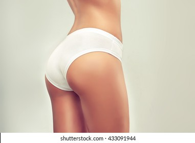 Perfect slim toned young body of the girl . An example of sports , fitness or plastic surgery and aesthetic cosmetology. .Taut elastic ass . Firm buttocks .
