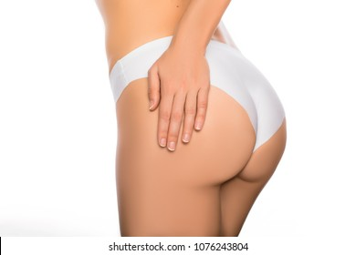 perfect slim woman body, butt in white panties closeup. Tight hips and firm buttocks .