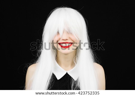 Perfect smile crazy woman in white wig with red lips. Fun girl with white beautiful teeth, school teacher style. Young cheerful girl having fun. Bright makeup and hairstyle black isolated background.