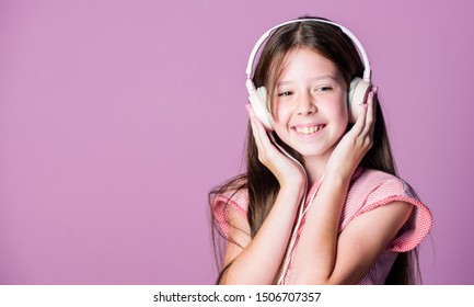 Perfect sound. Having fun. Listen for free. Enjoy music concept. Music app. Audio book. Educative content. Study english language with audio lessons. Girl listen music modern headphones gadget.