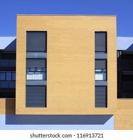 Perfect square. Many right angles in housing under bright sunlight.