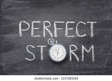 perfect storm phrase written on chalkboard with vintage stopwatch used instead of O