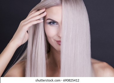 Perfect straight long grey hair, studio shot