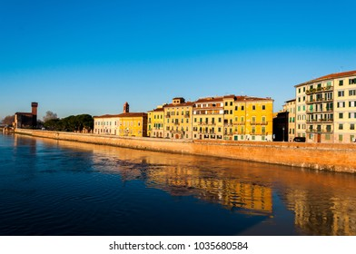 Perfect sunny morning in Pisa on the river, surrounded by old houses