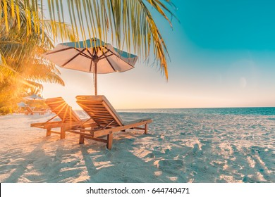 Perfect sunset beach. Idyllic tropical beach landscape for background or wallpaper. Design of summer vacation holiday concept.