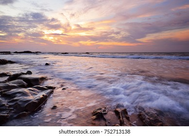 perfect sunset with sharp rocky seashore. amazing seascape