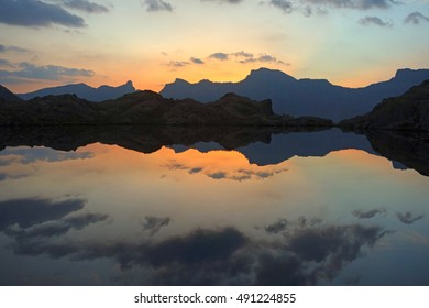 Perfect sunset with small lake in French Alps