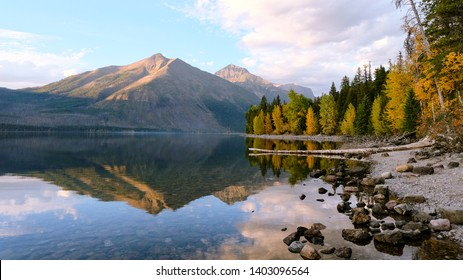 A perfect sunset view from the rocky shores of Lake McDonald in Glacier National Park, Montana.