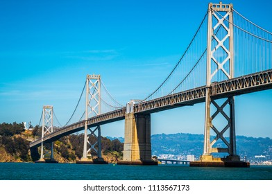 Perfect sunshine on Bay Bridge from Oakland to San Francisco a traffic bottleneck congestion during rush hour but a gorgeous steel suspension bridge spanning across the Bay Area in Northern California